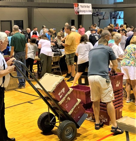 Hundreds of volunteers recently packed bags for Huetytown Community Helpers' Blessings in a Bag program. (Morgan Jackson / Alabama NewsCenter)