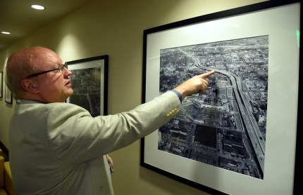 Tad Snider, BJCC president and chief executive officer, describes an early photo at the Birmingham-Jefferson Convention Complex as construction begins on the arena. (Mark Almond/The Birmingham Times)