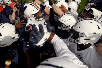 Auburn defensive star Derrick Brown (5) breaks down the team to start practice in preparation for Wednesday's Outback Bowl. (Todd Van Emst/AU Athletics)