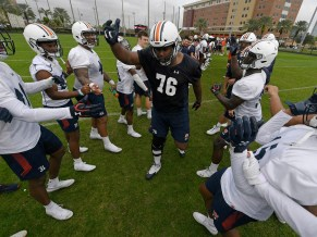 Prince Tega Wanogho (76) celebrates his last practice at Auburn. (Todd Van Emst/AU Athletics)