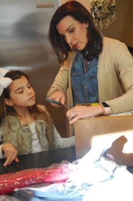 Ashley Selgson works on Christmas gifts for the homeless with her daughter Brooklyn. (Karim Shamsi-Basha / Alabama NewsCenter)