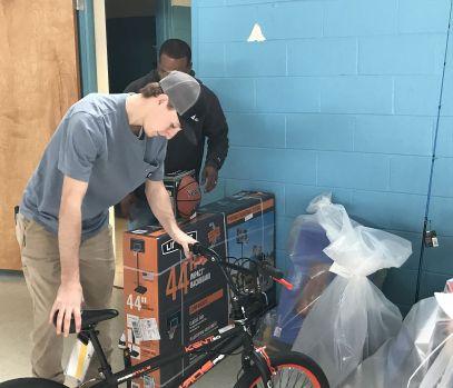 Ezekiel delivers a bike. (Donna Cope/Alabama NewsCenter)