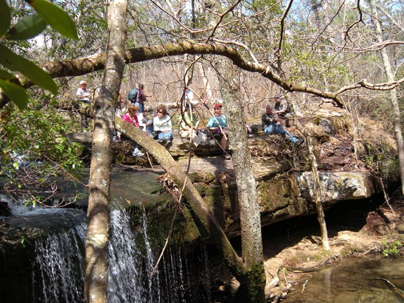 Southeastern Outings hike participants enjoying lunch beside Lost Falls. (Contributed by a Southeastern Outings member)