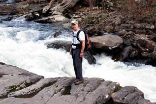 Dan Frederick, President of Southeastern Outings, beside small fall on West Fork of Little River. (Ray Hara)