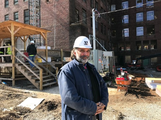 Developer Ed Ticheli stands near the American Life building in Birmingham, where renovations to turn the tower into 140 apartments have reached the halfway mark. (Michael Tomberlin/Alabama NewsCenter)