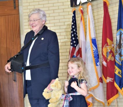 Ivey received a surprise gift from a youngster. (Donna Cope/Alabama NewsCenter)