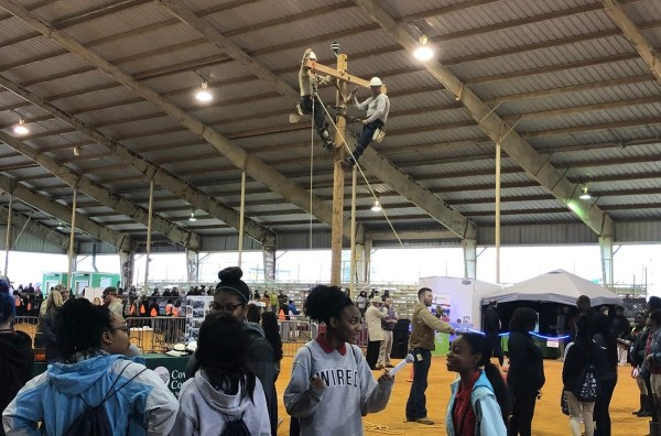 Alabama Power linemen demonstrate their skills for the students attending Southeast Alabama Worlds of Work in Dothan. (Brooke Goff/Alabama NewsCenter)