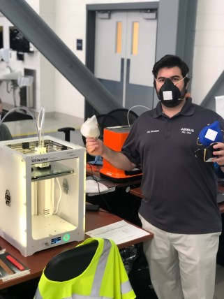 Eric Cleveland, part of the Airbus team that 3D-printed personal protective equipment for the University of South Alabama's USA Health, holds up a completed face mask at the Airbus Final Assembly Line facility in Mobile. (Image courtesy of Airbus)