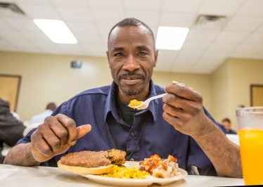 A client enjoying a meal at the Jimmie Hale Mission. (Image courtesy of the Jimmie Hale Mission)