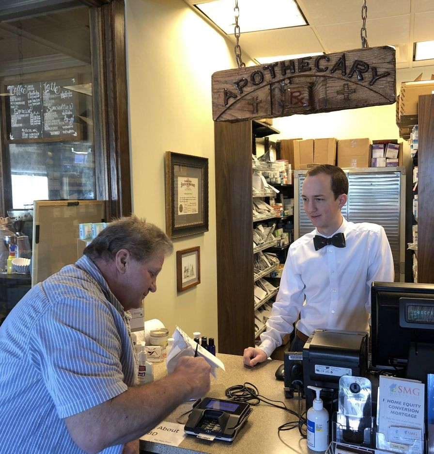 Honea helps a customer at Chelsea Apothecary. (Jeff Honea/Chelsea Apothecary)