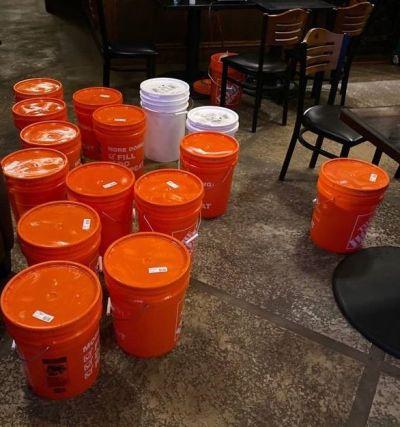 Orange canisters hold hand sanitizer. (Jeff Honea)