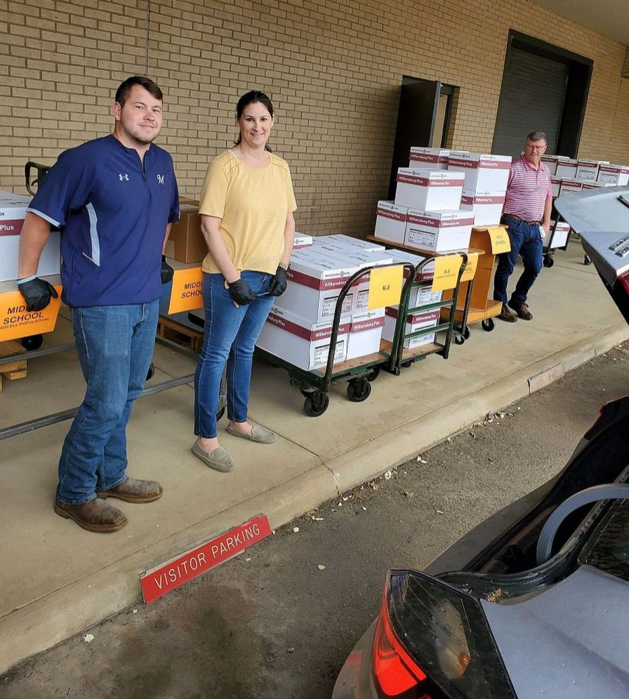Print Shop employees helped load materials into waiting vehicles for delivery to 42 schools. (Alabama Power Print Shop)