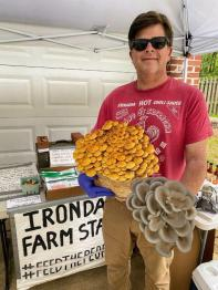 Tim Pfitzer shows off some 'shrooms at Irondale Farm Stand. (Bradleigh Turnipseed Pfitzer)