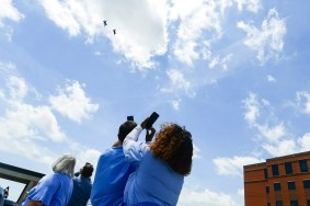 Red Tails from the Alabama National Guard's 187th Fighter Wing conduct a flyover for health care workers at East Alabama (Shanna Lockwood / AU Athletics)