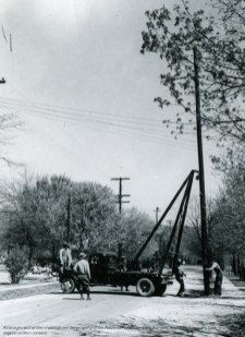Transmission pole installation. (Alabama Power Company Archives)
