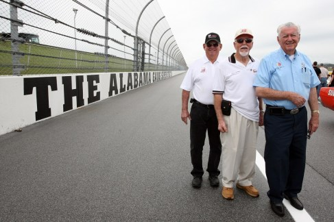 Red Farmer, center, poses on the Alabama Gang Superstretch at the Talladega Superspeedway. (Talladega Superspeedway)