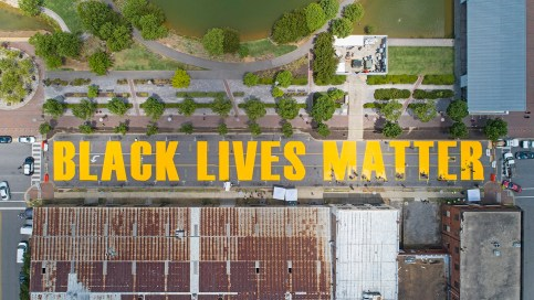 The BLACK LIVES MATTER street mural came together in less than two days. (Jay Parker / Alabama NewsCenter)