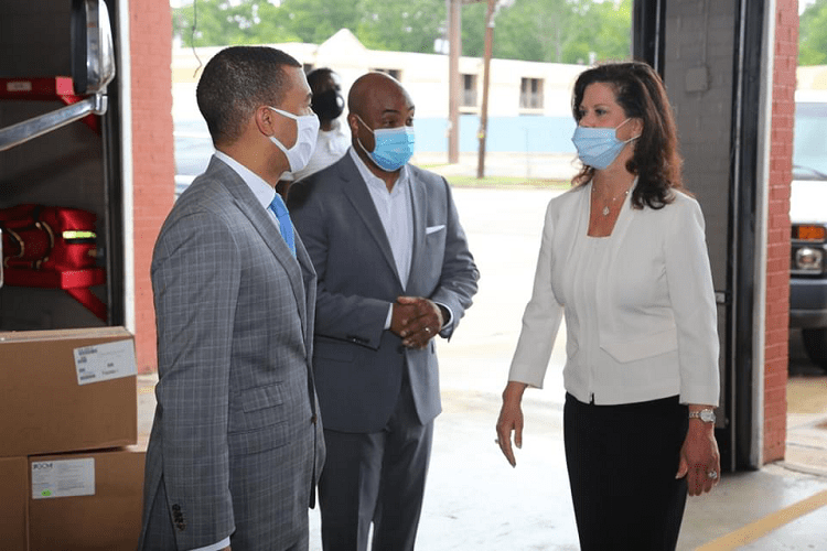 At the AFLAC donation were, from left, Montgomery Mayor Steven Reed, retired Brig. Gen. Trent Edwards from the Montgomery Area Chamber of Commerce and Leslie Sanders, vice president of Southern Division for Alabama Power. (Michael Jordan / Alabama NewsCenter)