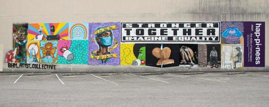 What started as a collaborative mural project led by BHM Artist Collective to honor health care workers in the COVID-19 fight morphed to include promoting unity as part of the Black Lives Matter movement. (Phil Free / Alabama NewsCenter)