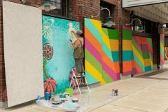 Helga Mendoza works on an art project in Birmingham. (Phil Free / Alabama NewsCenter)