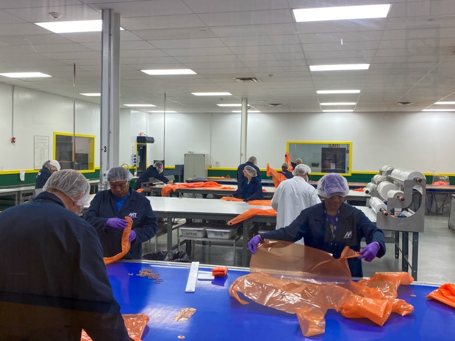 In April 2020 Muskogee Technology responded to the desperate need for personal protection equipment by modifying its cutting and kitting equipment to produce custom isolation gowns for local hospitals and other healthcare establishments. (contributed)