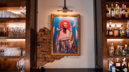 Two colorful paintings by guitarist Browan Lollar of St. Paul and the Broken Bones are behind the stunning stone-topped bar. (Dennis Washington / Alabama NewsCenter)