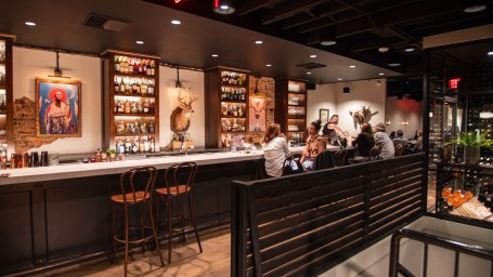 The natural, earthy elements on display in the dining rooms and bar and the wood-scented atmosphere throughout Helen echo Rob McDaniel's philosophy of respecting the land and using it as inspiration in his kitchen. (Dennis Washington / Alabama NewsCenter)