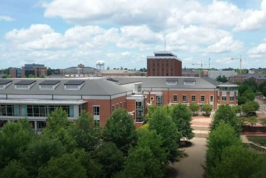 The new Harold D. Melton Student Center with Haley Center in the background. (Auburn University)