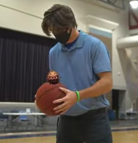 """Dr. Quentin Lee and his crew at Childersburg High School decided some special effects were needed for their second COVID-19 safety video, """"Germ Busters."""" In this scene, a student discovers a nasty-looking germ on a basketball. (contributed)"""