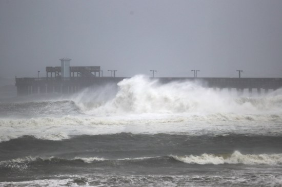 Waves break ashore near the Gulf State Park pier as Hurricane Sally came ashore in Gulf Shores, Alabama. The pier was heavily damaged by the storm. (Joe Raedle/Getty Images)