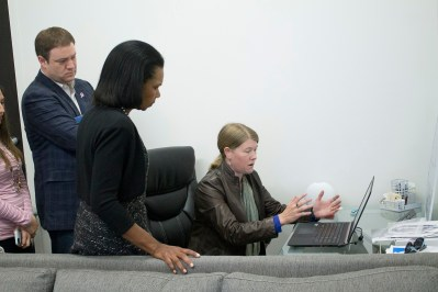 GlobalXplorer's Sarah Parcak demonstrates the processing of satellite imagery for archaeology to former Secretary of State Condoleezza Rice. (GlobalXplorer)