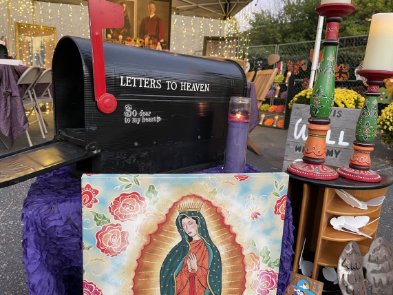 "Offering ""letters to heaven"" addressed to the deceased. (Ike Pigott/Alabama NewsCenter)"