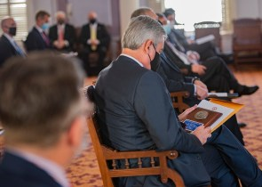 Alabama Power CEO Mark Crosswhite holds the Medallion Award presented to the company by Alabama Secretary of State John H. Merrill. (Wynter Byrd / Alabama NewsCenter)