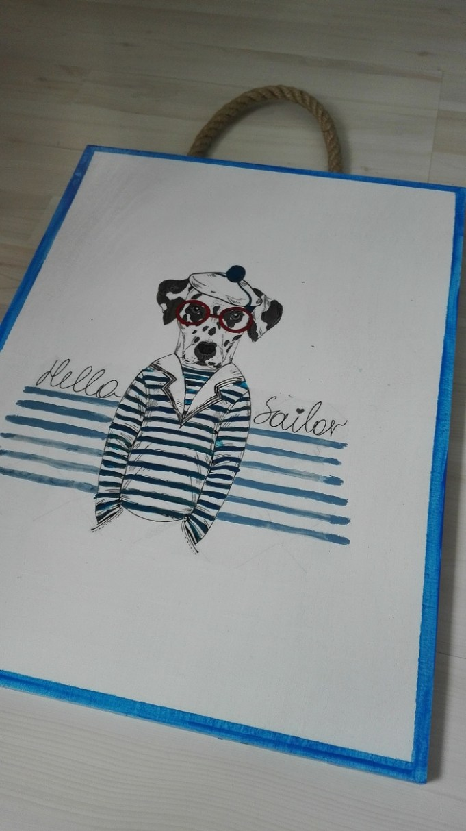 Obrazek w stylu marynistycznym - pies hipster- żeglarz