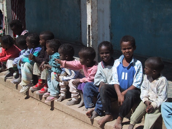 Children waiting for their shoeboxes full of gifts.
