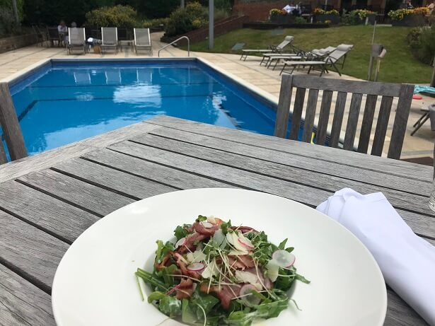 Caesar salad by the outdoor pool