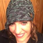 Jenn Green crocheted up this fun hat using my Northern Lights Vortex colorway and the Buttoned Emma Hat: http://www.ravelry.com/patterns/library/buttoned-emma-hat