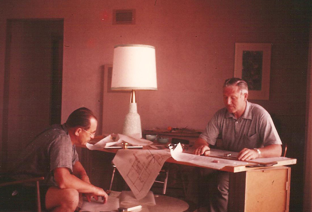 Kenny Birkemeier, right, and a building partner prepare drawings for a new home. Photo courtesy of Dan Birkemeier.