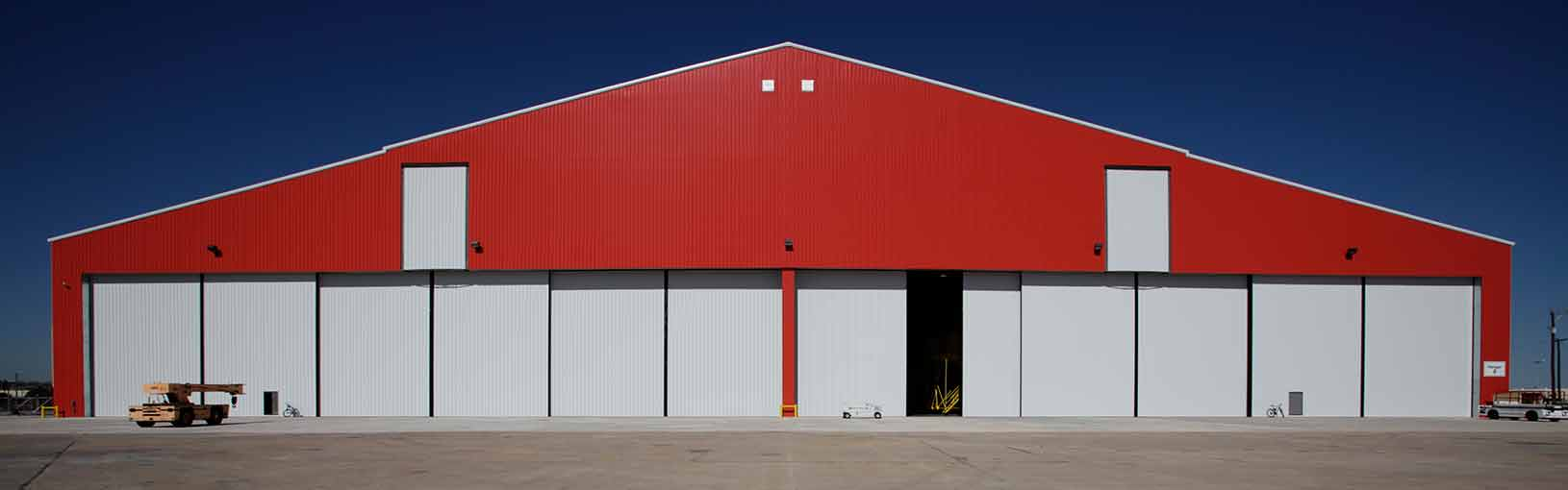 Bottom Rolling Hangar Doors on a red Hangar