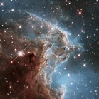To celebrate its 24th year in orbit, the NASA/ESA Hubble Space Telescope has released this beautiful new image of part of NGC 2174, also known as the Monkey Head Nebula. NGC 2174 lies about 6400 light-years away in the constellation of Orion (The Hunter). Hubble previously viewed this part of the sky back in 2011 — the colourful region is filled with young stars embedded within bright wisps of cosmic gas and dust. This portion of the Monkey Head Nebula was imaged in the infrared using Hubble's Wide Field Camera 3.