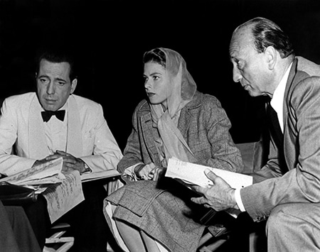 photo of Humphrey Bogart, Ingrid Bergman, director Michael Curtiz during the filming of Casablanca