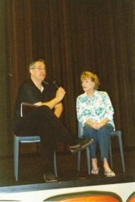 photo of Nancy Gates and Alan K. Rode seated side by side on stage