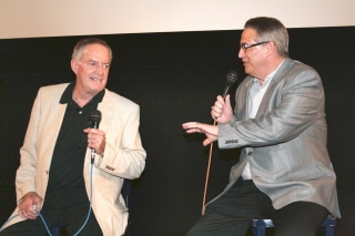photo of Robert Dix and Alan K. Rode seated on stage