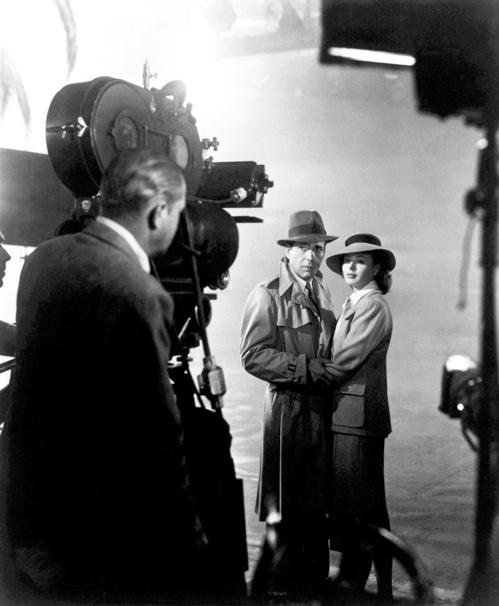 photo of Humphrey Bogart and Ingrid Bergman on set with Casablanca director of photography Arthur Edeson
