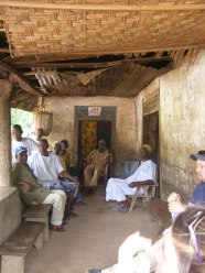 The Paramount Chief awaits the villagers to arrive