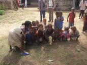 The kids crowd around...