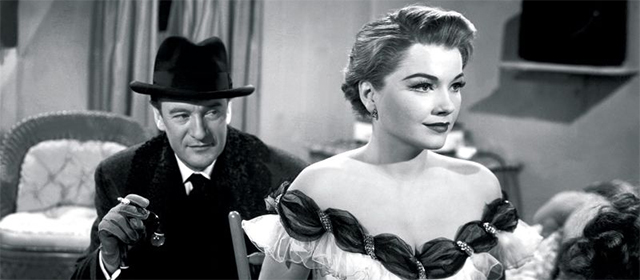 George Sanders et Anne Baxter dans Eve (1951)