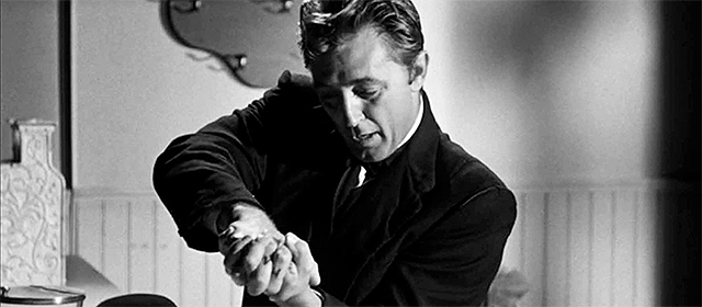 Robert Mitchum dans La Nuit du chasseur (1955)