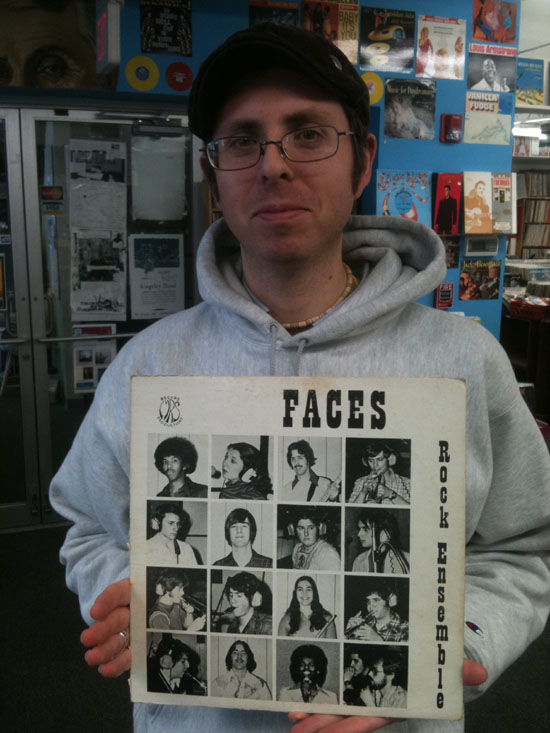 Tim holds The Rock Ensemble 77's Faces