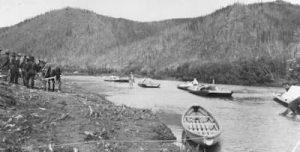 Horse-towed freight scows arrive at Ophir, on the upper Innoko River, from Dishkaket on July 24, 1910. Photo by A.G. Maddren, USGS public domain image.
